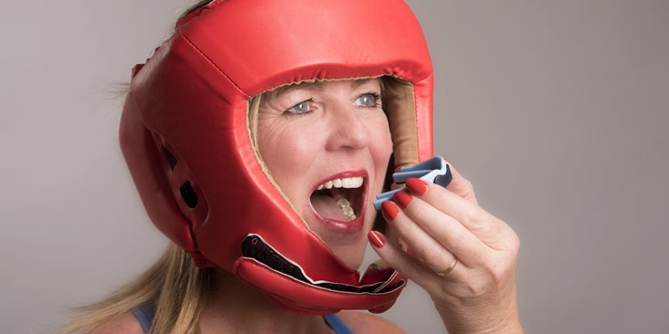 Female boxer with mouthguard
